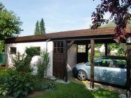 Flachdach-Carport nach Bauherrenwunsch mit Gartenhaus Trendy von links
