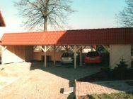 Großraum-Carport mit roter Dachstein-Blende als Pultdach